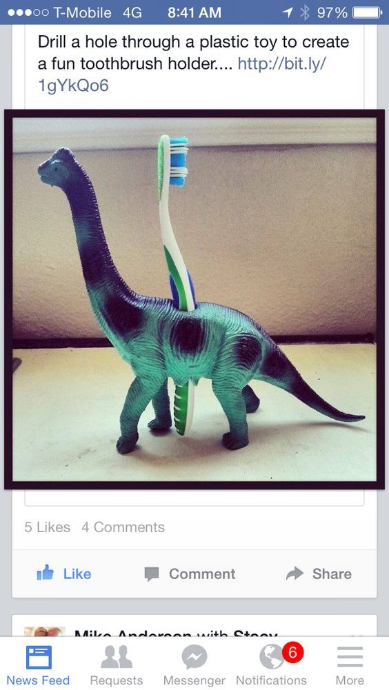DIY toothbrush holder with hollowed out dinosaur toy holding toothbrush