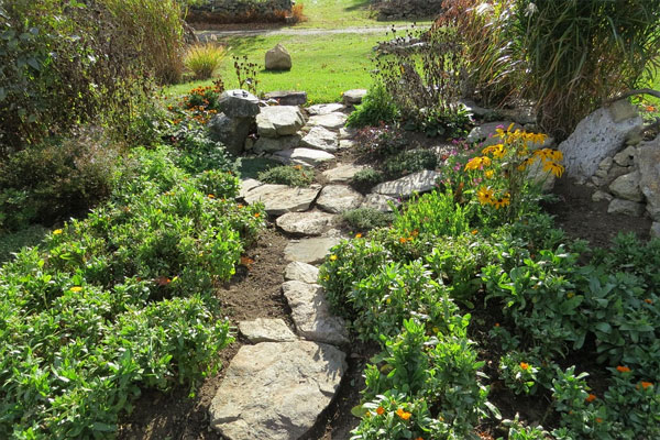 flat stones as a pathway to garden